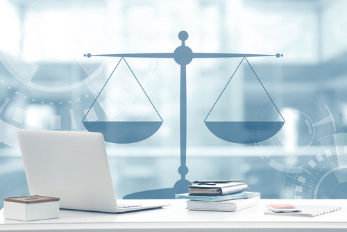 Law concept. Lawyer workplace with laptop and scales of justice